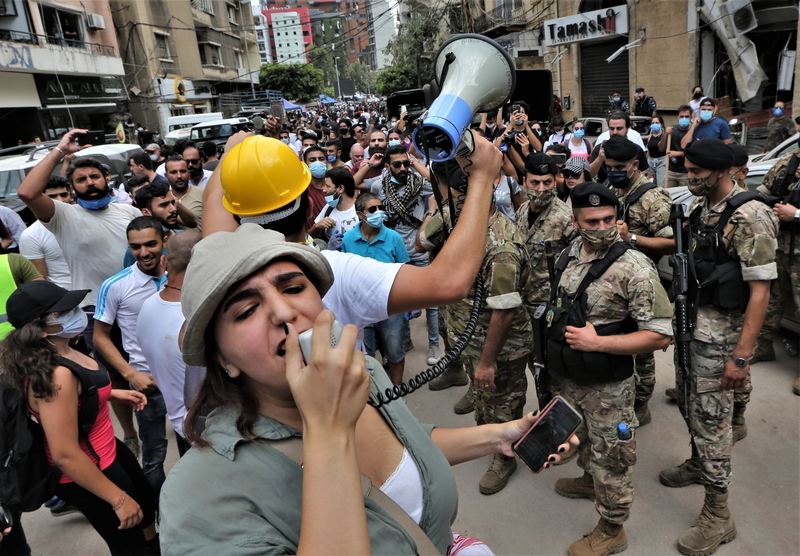 Anti-government protesters chant against the government in Beirut, Lebanon, on Agust 6, 2020.