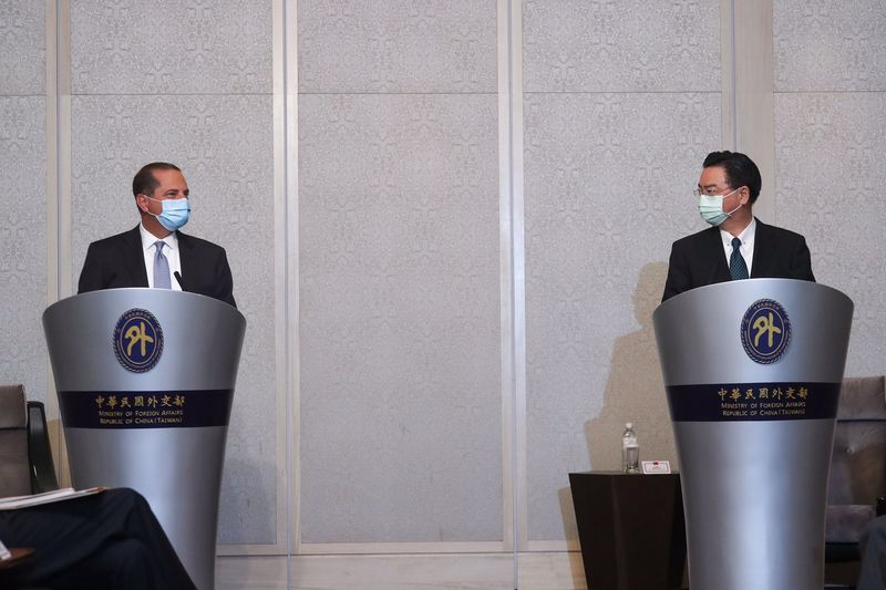 U.S. Secretary of Health and Human Services Alex Azar (L) speaks while meeting with Taiwan's Foreign Minister Joseph Wu (R) in Taipei on August 11, 2020.
