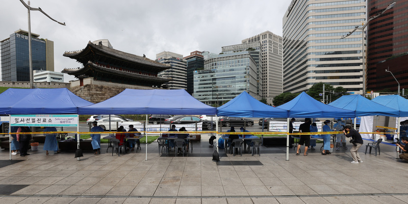 A temporary coronavirus screening clinic is set up near the Namdaemun Market in central Seoul.