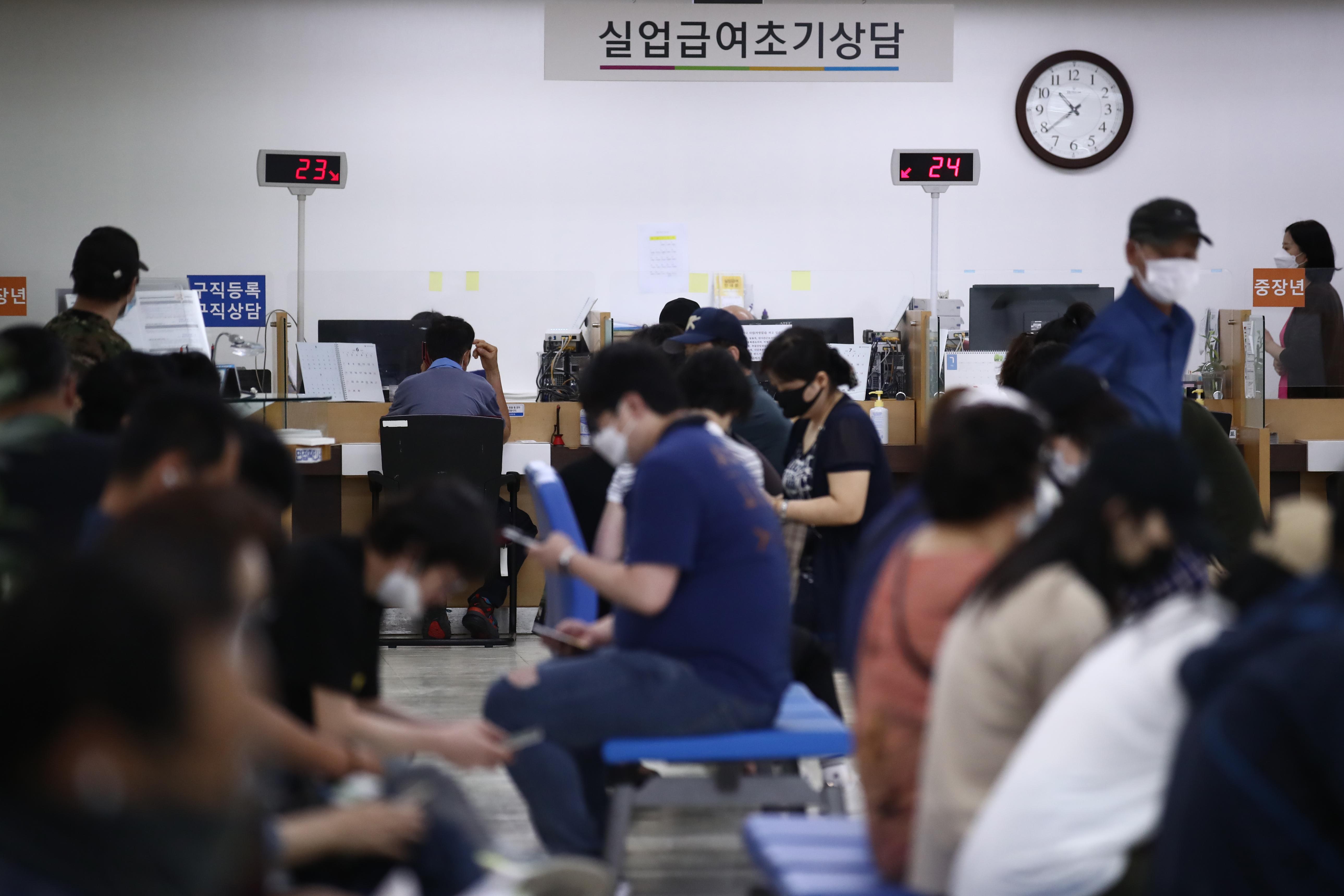 Job seekers crowd an Employment Welfare Plus Center in Seoul's Jung District.