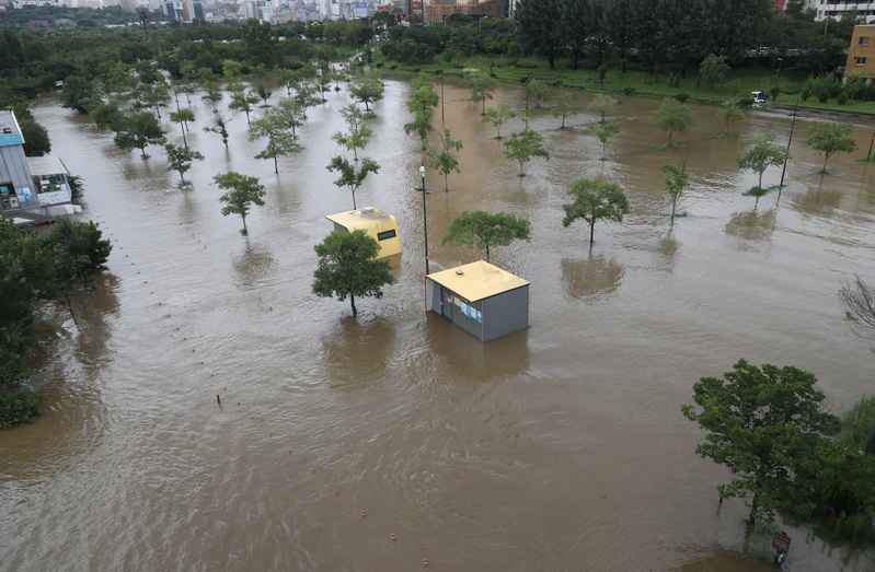 The Han River park in Seoul's Yeouido area is submerged in floodwater after heavy rains.