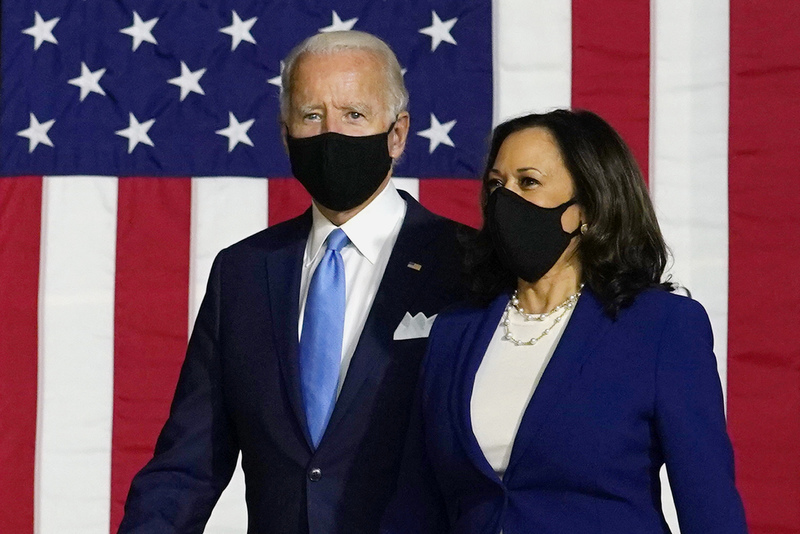U.S. Democratic presidential candidate former Vice President Joe Biden and his running mate Senator Kamala Harris arrive at their first campaign event in Wilmington, Delaware, on  August 12, 2020.