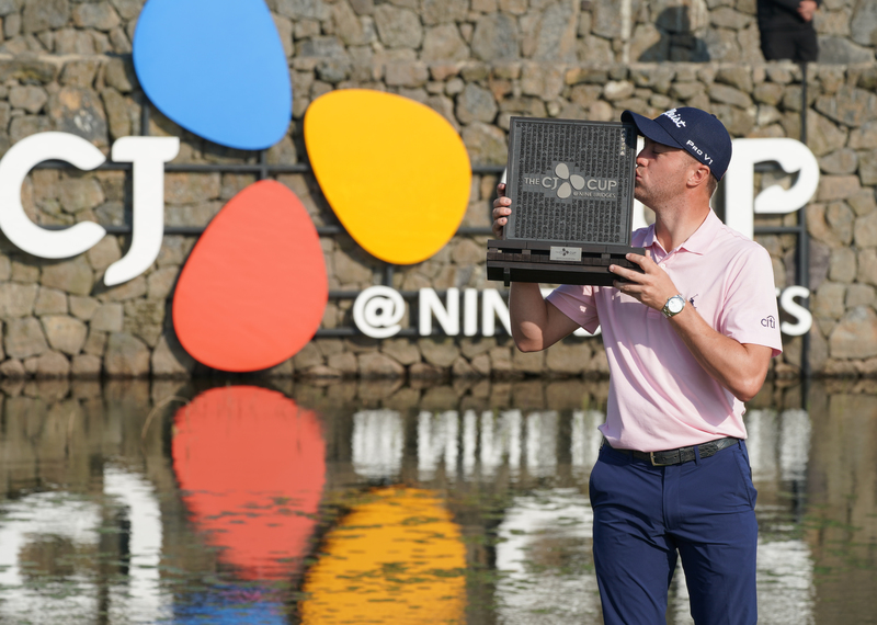 In this file photo from Oct. 20, 2019, Justin Thomas kisses the champion's trophy after winning the CJ Cup at Nine Bridges golf tournament in Jeju Island.