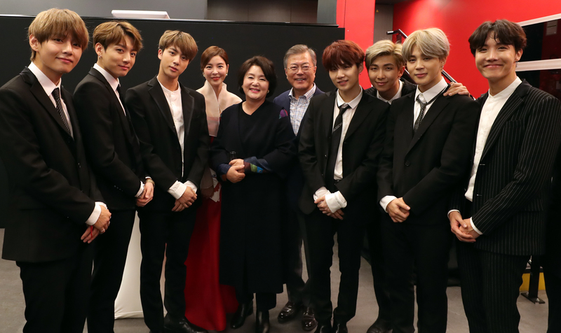 President Moon Jae-in and first lady Kim Jung-sook pose with South Korean boy band BTS at a Korea-France friendship concert in Paris on Oct. 14, 2018.