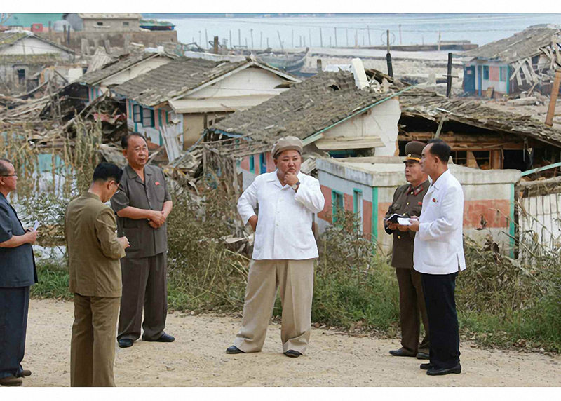 North Korean leader Kim Jong-un (C) inspects an area damaged by Typhoon Maysak in the country's eastern South Hamkyong Province, in this photo published by the Rodong Sinmun newspaper on Sept. 6, 2020.