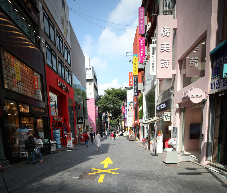 A store-lined street in Seoul's popular Myeongdong shopping district remains unusually empty during midday on Sept. 15, 2020, amid a decline in business due to the coronavirus outbreak.