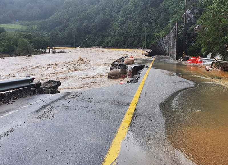 A section of a local road in Samcheok, Gangwon Province, is destroyed by heavy downpours and flooding brought on by Typhoon Haishen on Sept. 7, 2020.