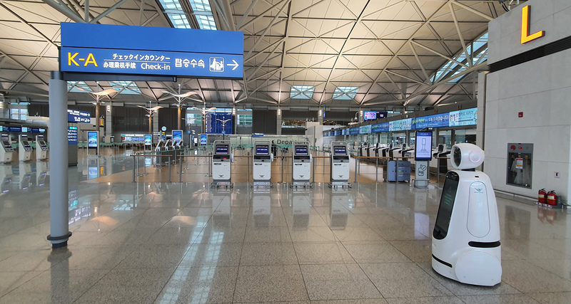 A robot roams an empty departure hall at Incheon International Airport.