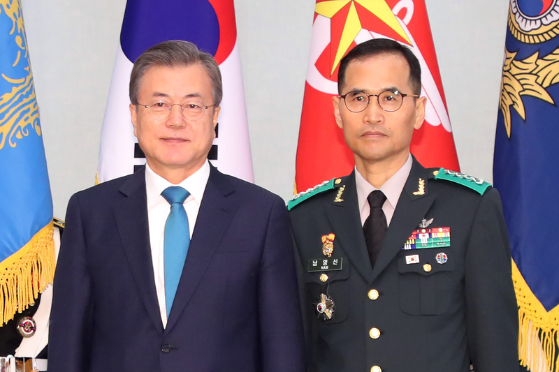 Ground Operations Command chief Gen. Nam Yeong-shin (R) poses for a photo with President Moon Jae-in at the presidential office Cheong Wa Dae in Seoul on April 15, 2020.