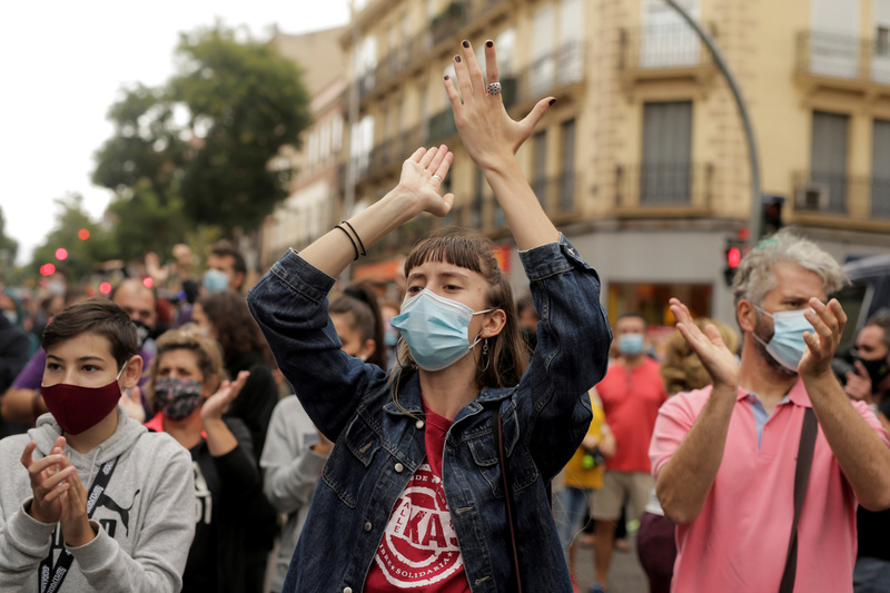 Madrid residents take to the streets to protest new coronavirus restrictions in Spain on Sept. 20, 2020.