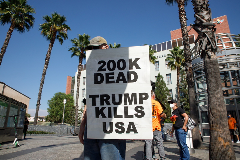 A protester holds a sign during a demonstration against U.S. President Donald Trump in Los Angeles, California, on Sept. 21, 2020.