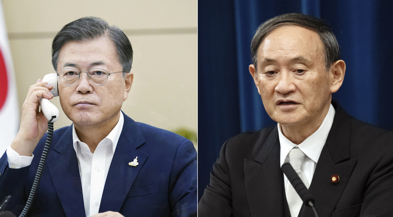 South Korean President Moon Jae-in (L) and Japanese Prime Minister Yoshihide Suga held their first official phone conversation on Sept. 24, 2020.