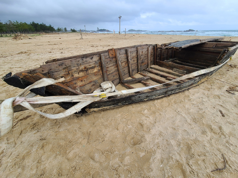 A damaged wooden boat, believed to have orginiated from North Korea, is found near Goseong, Gangwon Province, on Sept. 25, 2020.