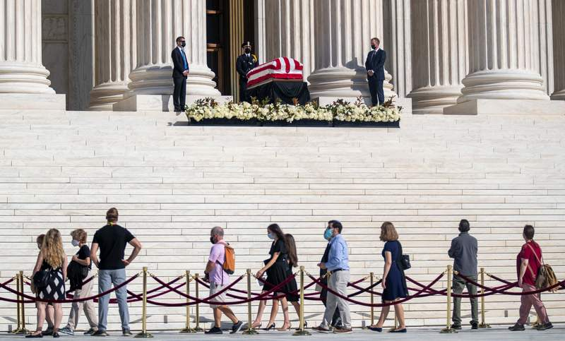 Former Supreme Court Justice Ruth Bader Ginsburg lays in repose on the steps of the Supreme Court in Washington, D.C., on Sept. 23, 2020.