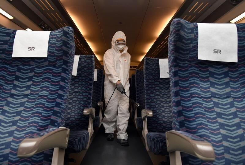 A worker in protective gear disinfects a Suseo express train ahead of the Chuseok holiday.