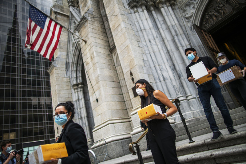 Mourners carried the remains of their loved ones who died from COVID-19 after a service at St. Patrick's Cathedral in New York in July.