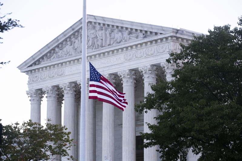 The U.S. flag flies at half-staff at the Supreme Court on the morning after the death of Justice Ruth Bader Ginsburg on September 19, 2020.