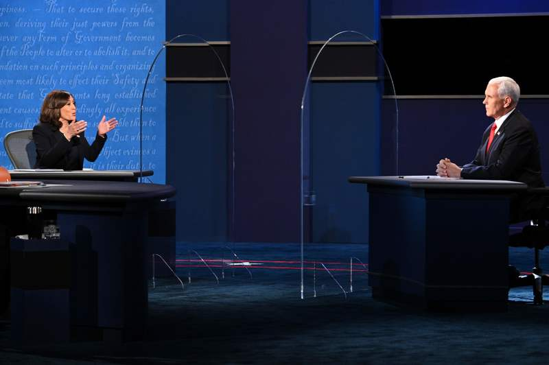 U.S. Vice President Mike Pence (R) and his Democratic challenger Kamala Harris clash during their first and only debate on Oct. 7, 2020.