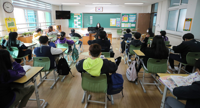 Students return to in-class instruction on Monday at Salesian Middle School in Gwangju amid eased restrictions on attendance caps and social distancing