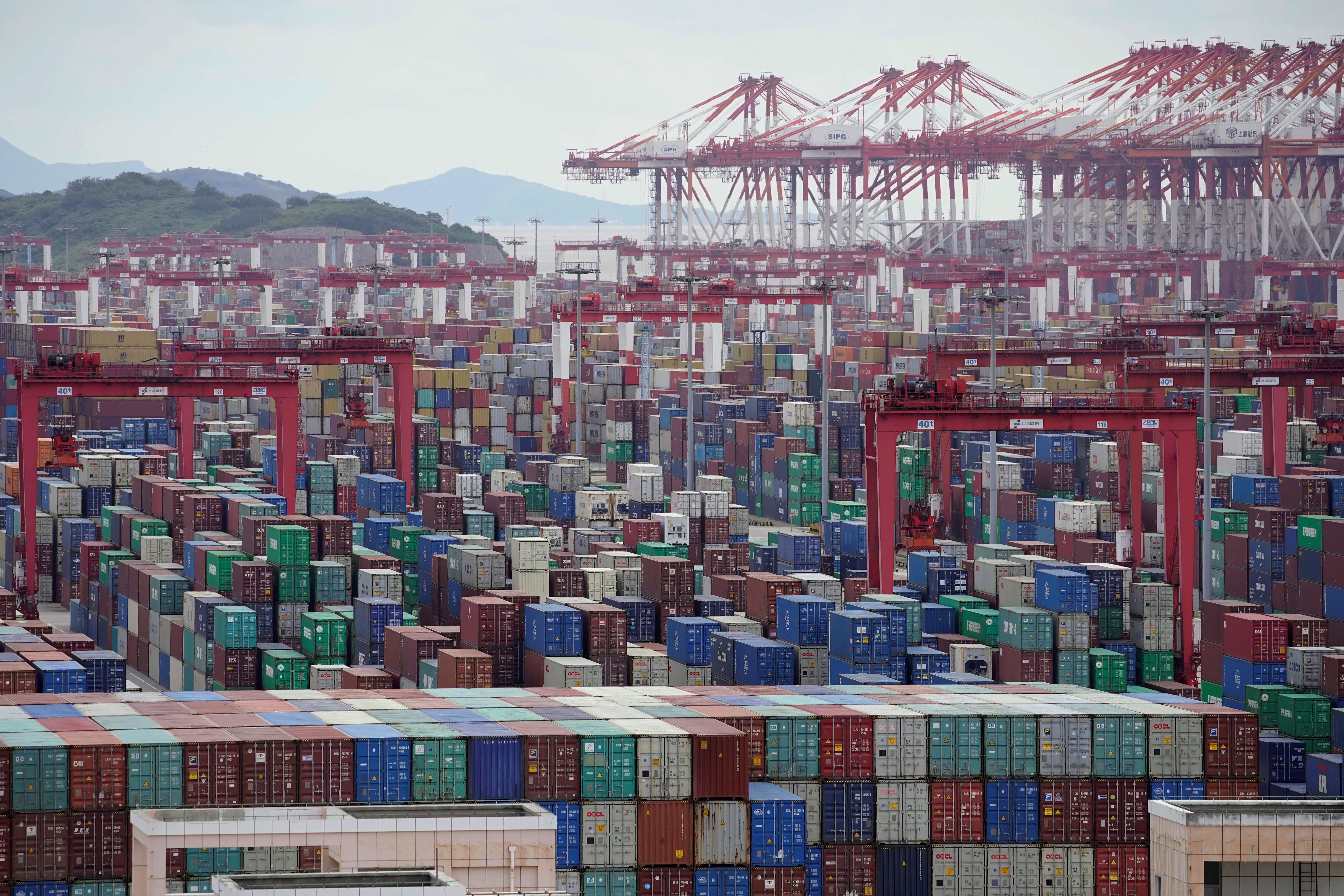 Containers are piled up at the Yangshan Deep-Water Port in Shanghai, China.