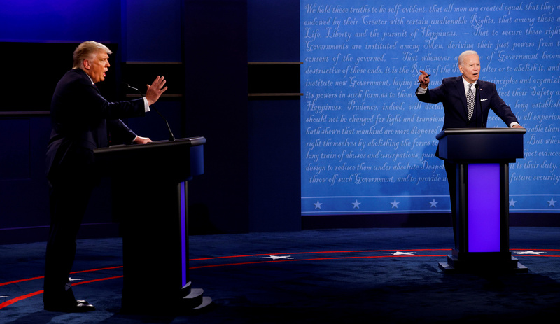 U.S. President Donald Trump (L) and his Democratic challenger Joe Biden clash during their first debate on Sept. 29, 2020.