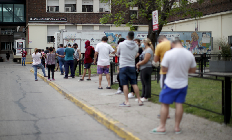 People line up to get COVID-19 tests at a hospital in Buenos Aires, Argentina, on Oct. 19, 2020.