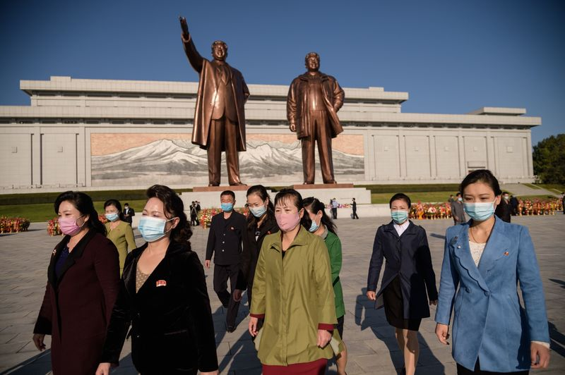 People leave Mansu hill after paying their respects before the statues of late North Korean leaders Kim Il-sung and Kim Jong-il on Oct. 10, 2020, as North Korea marked the 75th founding anniversary of its ruling party.
