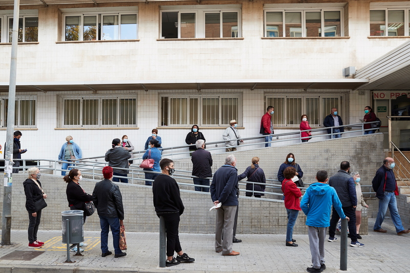 People wait to get tested for the coronavirus at a medical center in Barcelona, Spain, as health officials brace for a potential second wave of COVID-19.