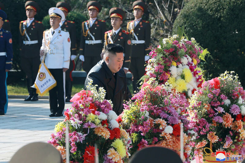 North Korean leader Kim Jong-un places a wreath at a cemetery in Hoechang, South Pyongan Province, for Chinese soldiers killed in the 1950-53 Korean War. This photo provided by Yonhap News was released by the North's official Korean Central News Agency on Oct. 22, 2020.