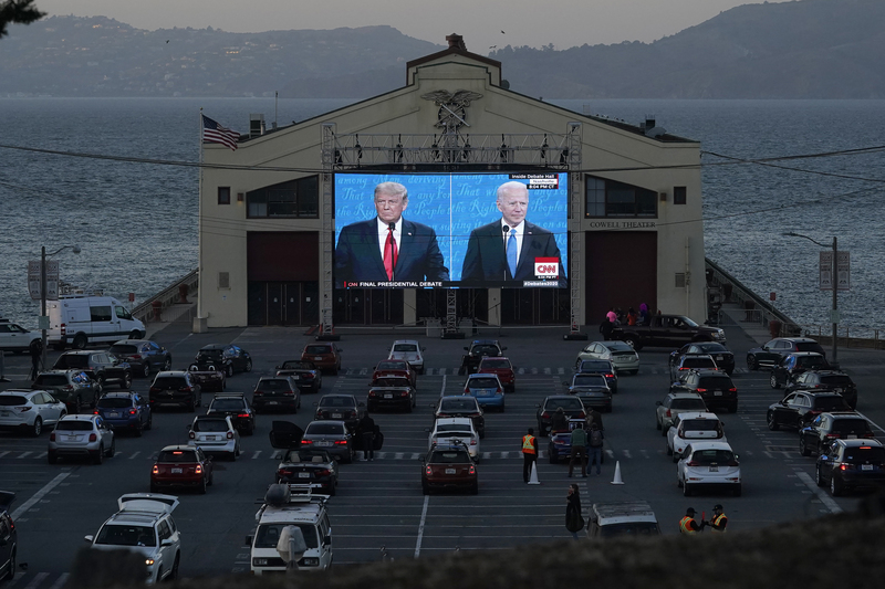 San Francisco residents watch the final presidential debate between Donald Trump and his Democratic challenger Joe Biden in their cars on Oct. 22, 2020.