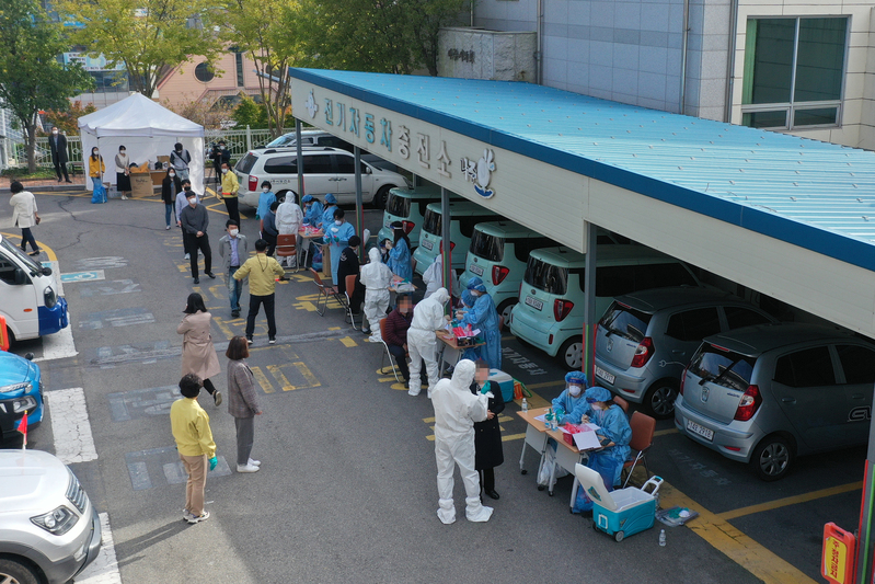 Medical workers set up an emergency COVID-19 testing center outside Naju City Hall after a city employee tests positive for the virus.
