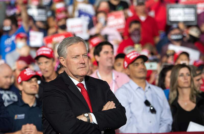 White House Chief of Staff Mark Meadows listens as U.S. President Donald Trump holds a campaign rally as he campaigns in Gastonia, North Carolina, on Oct. 21, 2020.