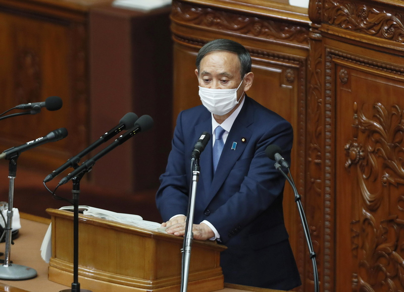 Japanese Prime Minister Yoshihide Suga delivers his policy speech during an extraordinary parliament session at the Upper House in Tokyo, Japan, on Oct. 26, 2020.