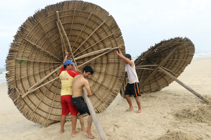 People remove beach cabanas ahead of Typhoon Molave in Danang, Vietnam, on Oct. 26, 2020.