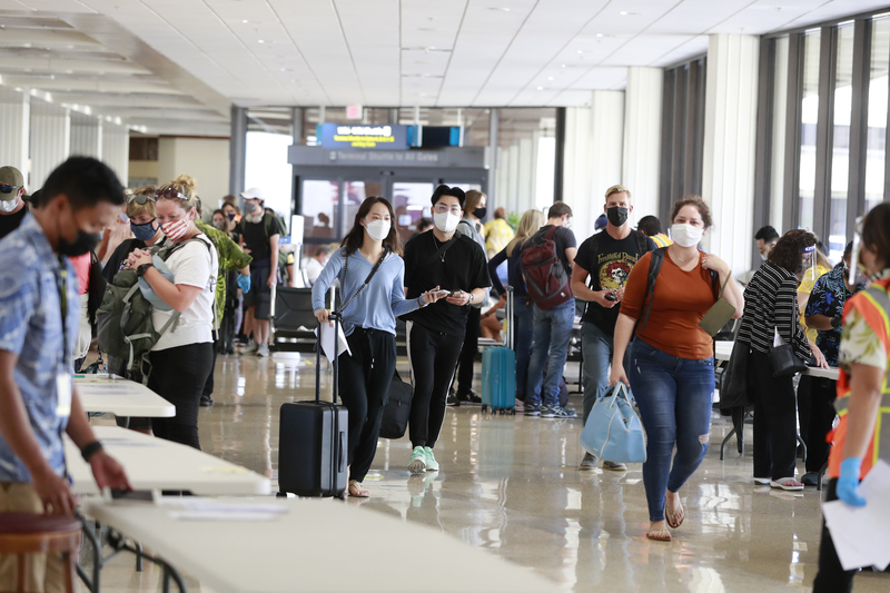 Visitors arrive at Daniel K. Inouye International Airport as they enter Hawaii.