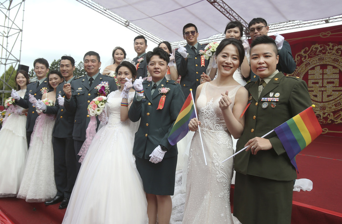 Two lesbian couples, Yi Wang and Yumi Meng (R), and Chen Ying-hsuan and Li Li-chen (L), pose for a photo during a military mass wedding ceremony in Taoyuan, Taiwan, on Oct. 30, 2020. (Photo: AP-Yonhap News)