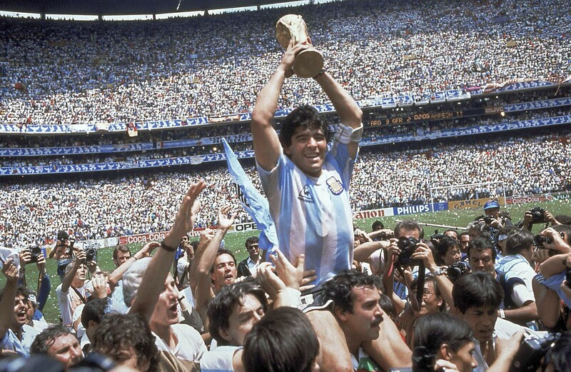 In this June 29, 1986 file photo, Diego Maradona holds up his team's trophy after Argentina's 3-2 victory over West Germany at the World Cup final at Atzeca Stadium in Mexico City. (Photo: AP-Yonhap News)