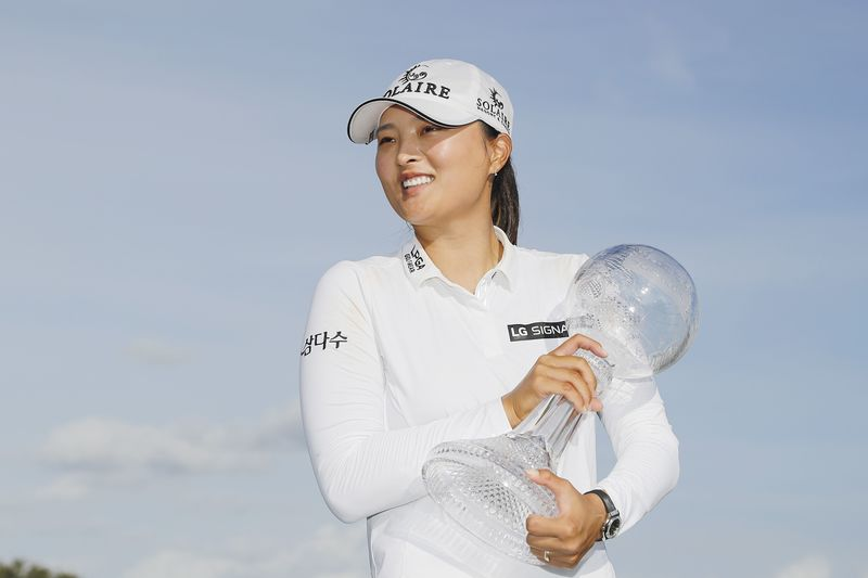 Ko Jin-young holds her trophy after winning the CME Group Tour Championship in Florida on Dec. 20, 2020. (Photo: AFP-Yonhap News)