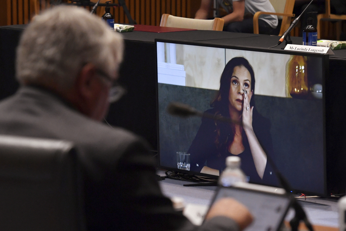 Mel Silva, right, the managing director of Google Australia and New Zealand, appears via a video link during a Senate inquiry into a mandatory code of conduct proposed by the Australian government. (Photo: AP-Yonhap News)