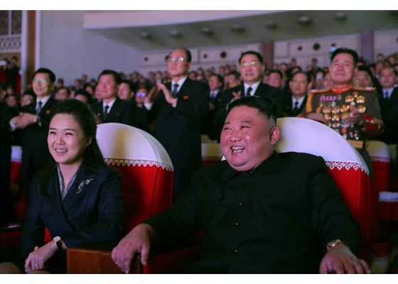 North Korean leader Kim Jong-un (R) and his wife, Ri Sol-ju, watch a performance in Pyongyang on Feb. 16, 2021. (Photo: Yonhap News)