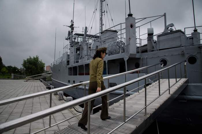 In this file photo, taken on July 28, 2017, a Korean People's Army guide walks aboard the USS Pueblo at the Victorious Fatherland Liberation War Museum in Pyongyang, North Korea. (Photo: Yonhap News)