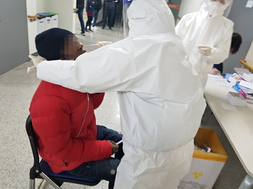 A foreign worker in Chungju, North Chungcheong Province, gets tested for the coronavirus. (Photo: Yonhap News)