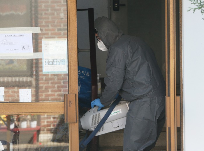 A worker in a hazmat suit carries out disinfection work near a daycare center in Incheon linked to a new COVID-19 cluster. (Photo: Yonhap News)