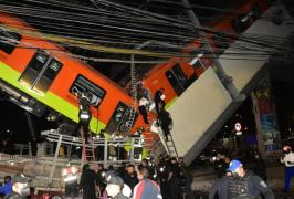 Rescuers work at a site where an overpass for a metro partially collapsed at Olivos station in Mexico City. Photo: EPA