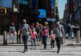 people walk through times square on May 17 (AFP-Yonhap)