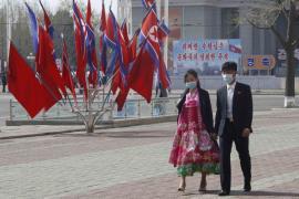 NK couple masks Pyongyang April15 AP