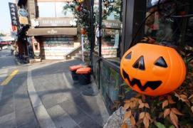 Halloween decorations cover a storefront in Seoul''s Itaewon neighborhood.