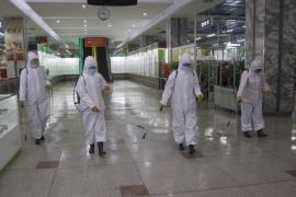 NK disinfection covid Pyongyang department store AP