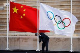China Olympic flags flame handover ceremony Athens Reuters